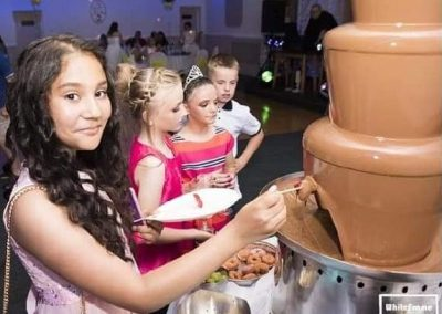 children enjoying a chocolate fountain at a wedding in liverpool