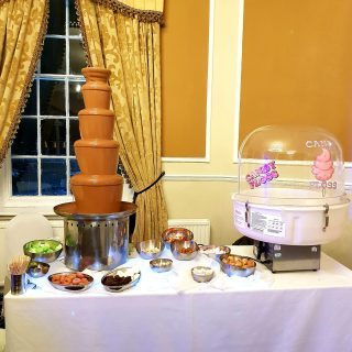 chocolate fountain and candy floss on a wedding at inglewood manor
