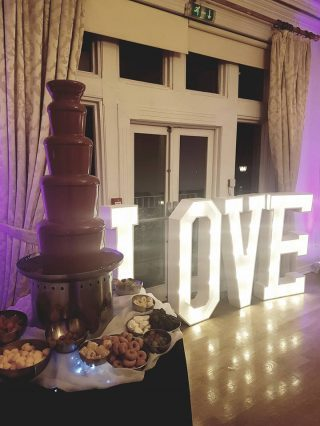 chocolate fountain and love signs at a wedding in the west tower aughton