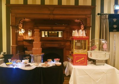 chocolate fountain candy floss and popcorn at a wedding