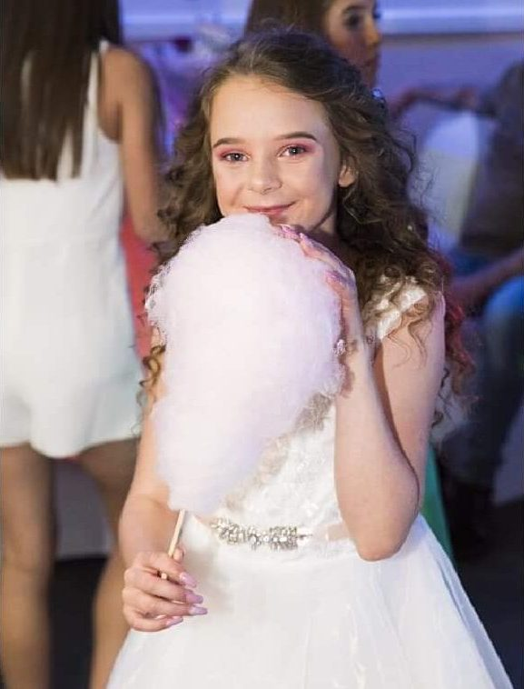 girl eating candy floss at a wedding in liverpool