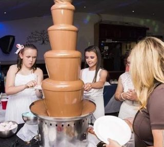 girls at a chocolate fountain at a wedding in liverpool